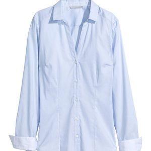 Light blue buttoned up shirt